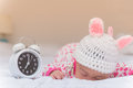 Cute baby girl and alarm clock wake up in the morning Royalty Free Stock Photography