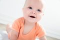 Cute baby girl with big eyes looking up close up blue Royalty Free Stock Photo