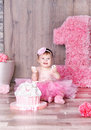 Cute baby girl eating first birthday cake. Royalty Free Stock Photo