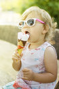 Cute baby girl eating ice cream outdoor Stock Photography