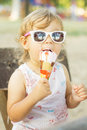 Cute baby girl eating ice cream outdoor Royalty Free Stock Photography