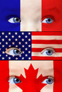 Cute baby girl with France, USA and Canada flags paint on her face Royalty Free Stock Photo
