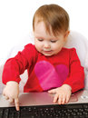 Cute baby girl holding laptop Stock Photography
