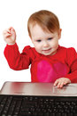 Cute baby girl holding laptop Stock Photo