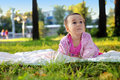 Cute baby girl lying on the grass in the park Royalty Free Stock Photo