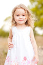 Cute baby girl in meadow