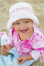 Cute baby girl playing on the beach Royalty Free Stock Photography