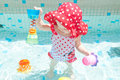 Cute baby girl in pool Royalty Free Stock Images