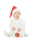 Cute baby girl in Santa's hat playing Royalty Free Stock Images