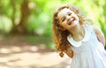 Cute baby girl shone with happiness curly hair charming smile sunny summer portrait Royalty Free Stock Photos