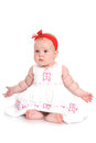Cute baby girl sitting Stock Images