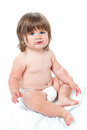Cute baby girl sitting up wearing a diaper Stock Images