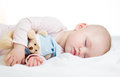 Cute baby girl sleeping with toy Stock Images