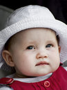 Cute baby girl smiles at the camera Stock Images