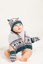 Cute baby with hat and scarf in studio Stock Photography