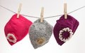 Cute baby hats three small hanging on line Stock Images