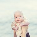 Cute baby human hands are holding adorable Royalty Free Stock Photography