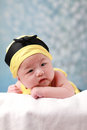 Cute baby lay down head on hand and watch Royalty Free Stock Photo