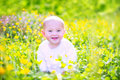 Cute baby n a blooming garden Royalty Free Stock Photo
