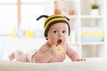 Cute baby with pacifier on the bed at home Royalty Free Stock Photo