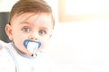 Cute baby pacifier looking camera Stock Image