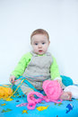 Cute baby playing with knitting closeup of a little infant boy in casual clothes in nursery wool Stock Photos