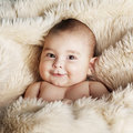 Cute baby portrait lying on fur happy Royalty Free Stock Images