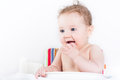 Cute baby sitting in a high chair waiting for dinner Royalty Free Stock Photo