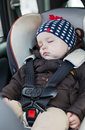 Cute baby sleeping in car seat boy Stock Images