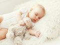 Cute baby sleeping on soft bed home