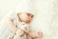 Cute baby sleeping on white bed at home
