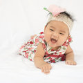 Cute baby smiling girl with rose headband asian smile big Stock Image