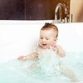 Cute baby splashing water Royalty Free Stock Photo