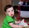 Cute baby staring with his big eyes funny at the camera blue Royalty Free Stock Photos