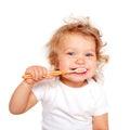 Cute baby toddler brushing teeth. Royalty Free Stock Photo