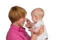 Cute baby touching mothers nose Royalty Free Stock Images