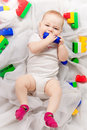 Cute baby with toys the craking multicolored angry Stock Photo