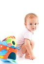 Cute baby with toys girl squatting on floor having Stock Photography