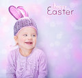 Cute baby wearing easter bunny costume portrait of cheerful little girl pink rabbit ears isolated on blur background with text Royalty Free Stock Image