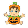 Cute baby wearing a jack o lantern costume Royalty Free Stock Images