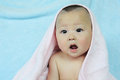 Cute baby whith pink towel sits wrapped in bath after bathing Stock Photography
