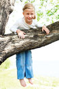 Cute barefoot girl hanging on the tree Royalty Free Stock Photo