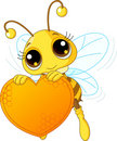 Cute bee holding a sweet  heart Royalty Free Stock Photos