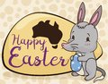 Cute Bilby Holding a Decorated Egg Celebrating the Australian Easter, Vector Illustration Royalty Free Stock Photo