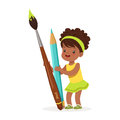 Cute black little girl holding giant light blue pencil and paintbrush cartoon vector Illustration Royalty Free Stock Photo