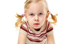 Cute blond fury furious adorable little girl frowning and leaning forward in anger Stock Photography