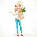 Cute blond girl with paper bag fresh fruits and vegetables stand standing on a white background Stock Photo