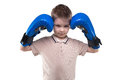 Cute blond little boy with boxing gloves Royalty Free Stock Photo