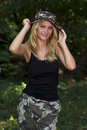Cute blonde dressed in camouflage Stock Image