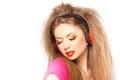 Cute blonde girl listening music on big headphones Stock Images